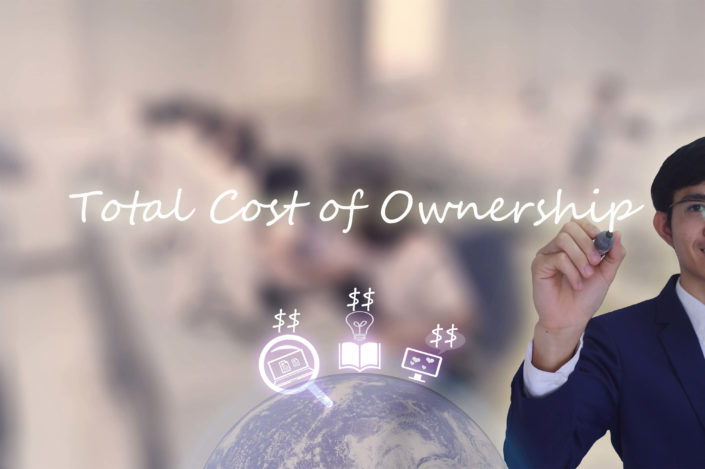 man writing total cost of ownership on the image