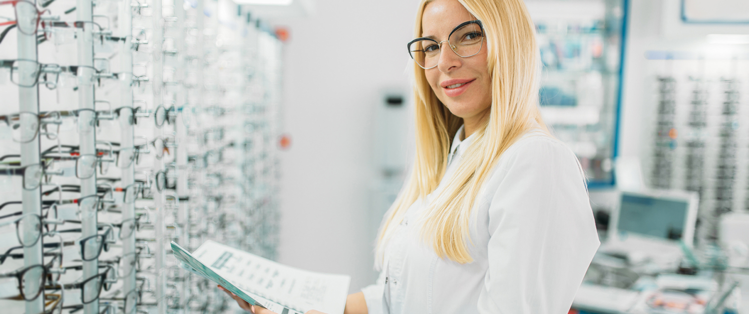 Woman wearing glasses and holding a product manual
